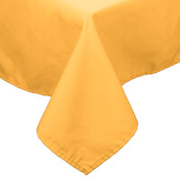 54 inch x 120 inch Gold 100% Polyester Hemmed Cloth Table Cover