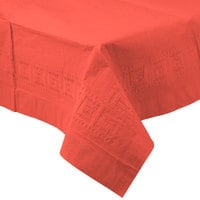 Creative Converting 713146B 54 inch x 108 inch Coral Orange Tissue / Poly Table Cover - 24/Case