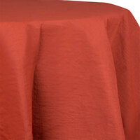 Creative Converting 923121 82 inch Brick Red OctyRound Tissue / Poly Table Cover - 12 / Case