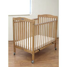 L.A. Baby CW883A Natural 24 inch x 38 inch Folding Wood Crib with 3 inch Vinyl Covered Mattress