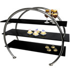 Eastern Tabletop AC1750BK 23 inch x 9 1/2 inch x 21 inch Stainless Steel 3 Tier Circular Tabletop Display Stand with Black Acrylic Shelves
